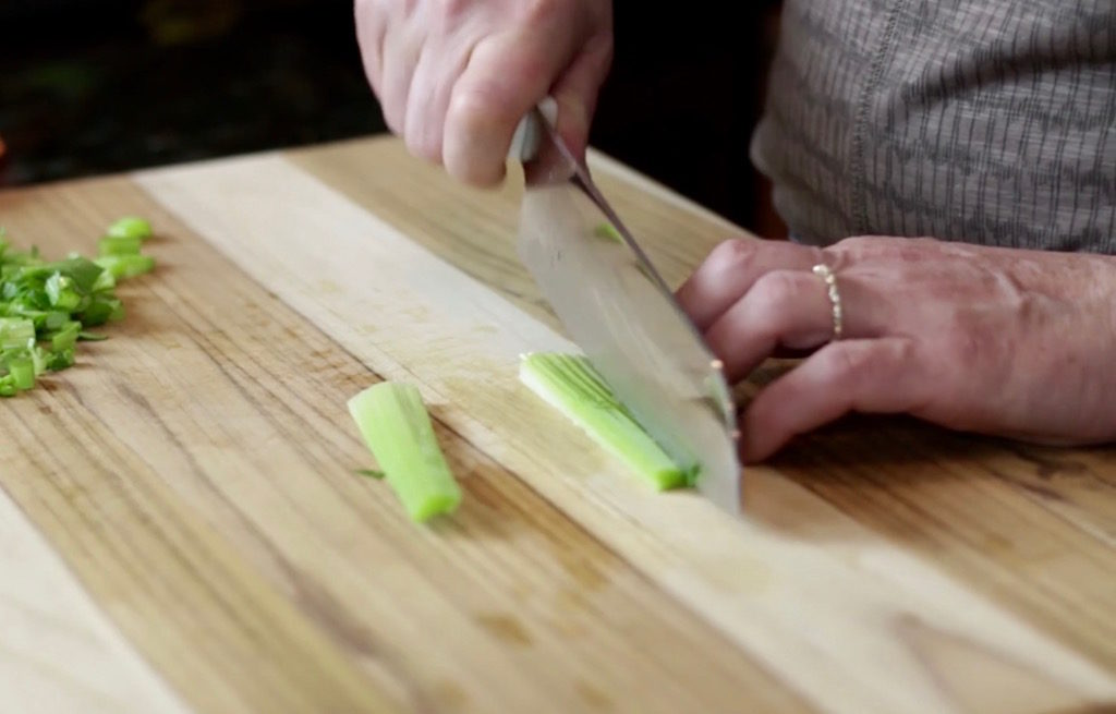 Cut the celery lengthwise in half and each half in half for a 1:4-inch dice.