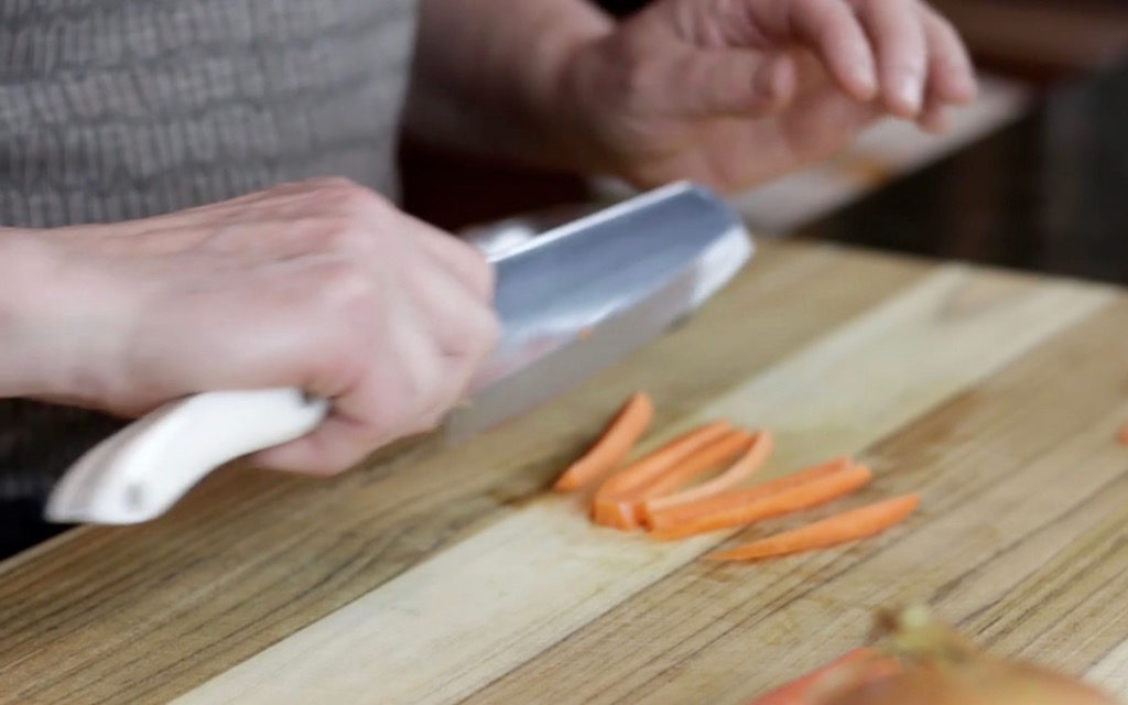 Slice the carrot in half then in half again and once more for a 1:4-inch dice.
