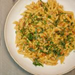 bowl of penne alla vodka pasta with garnish