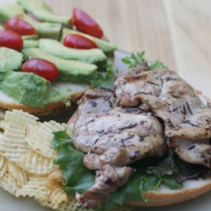 grilled boneless chicken thigh sandwich with chips